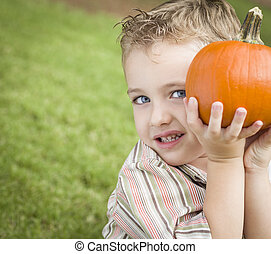 Child Boy Enjoying the Pumpkin