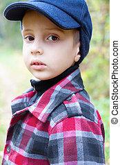child boy fashion portrait check coat wool cap