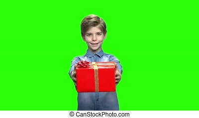 Child boy giving red gift box.