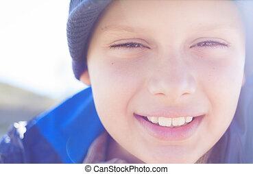 child boy happy face closeup outdoor