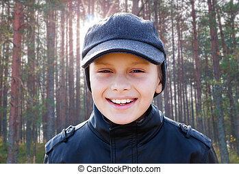 child boy happy smile backlight portrait sunshine forest backgro