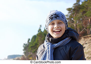 child boy happy smile hat scarf outdoor
