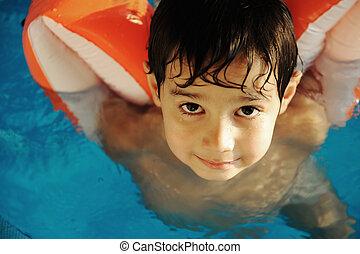 Child boy in pool