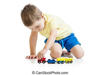 child boy playing toys isolated n white background