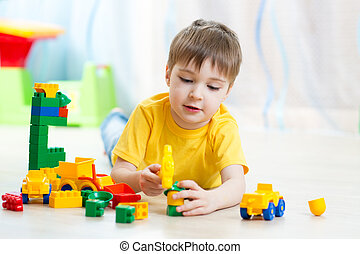 child boy playing with block toys at home - child playing...