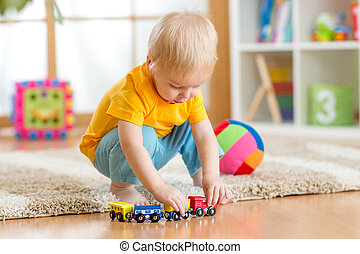 child boy playing with toys indoor