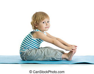 Child boy practicing yoga, stretching in exercise. Kid isolated over white background