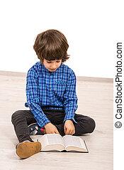 Child boy reading a book