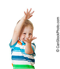 child boy showing something isolated on white background