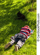 Child boy sleeping in grass