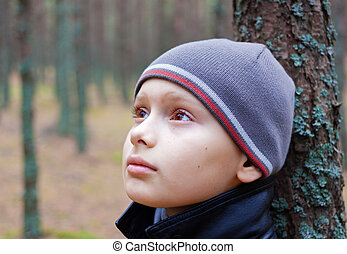 child boy thoughtful pensive alone forest wood