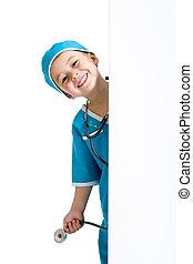 child boy uniformed as doctor behind banner