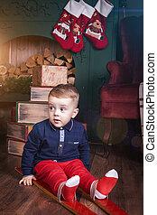 child boy wearing ski sitting indoor