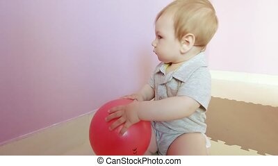 Child boy with a plastic ball