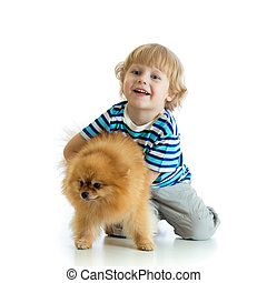Child boy with dog spitz, isolated on white background