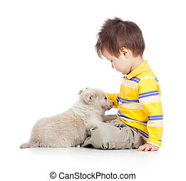 child boy with puppy dog