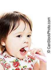 Child brushes teeth