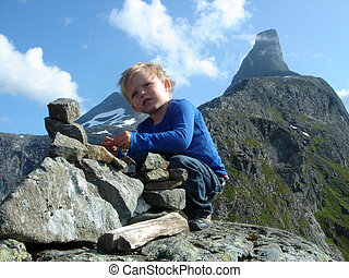 Child building cairn