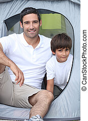 Child camping with his father