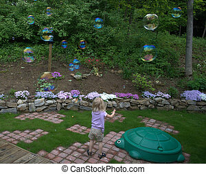 Child Chasing Bubbles