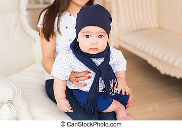 Child, childhood and infant concept - close-up of happy little baby boy at home with his mother