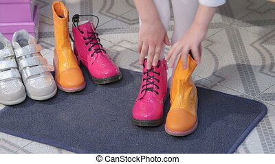 footwear in shoe store - Child chooses footwear in shoe...