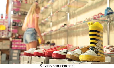 Child Choosing Footwear - Little girl choosing summer...