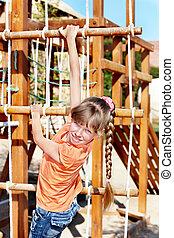 Child climbing on slide.