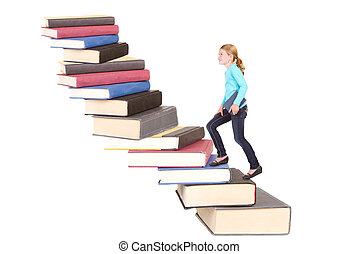 child climbing staircase of books