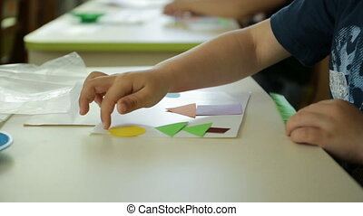 Child collects a color picture. Art handmade. Cut out...