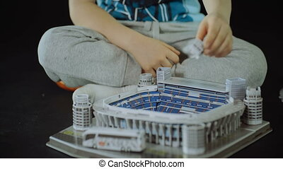 child collects toy sport Stadium close shot slider black background