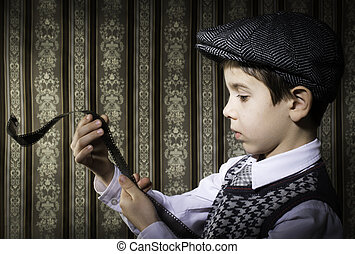 Child considered analog photographic film. Vintage clothes and background
