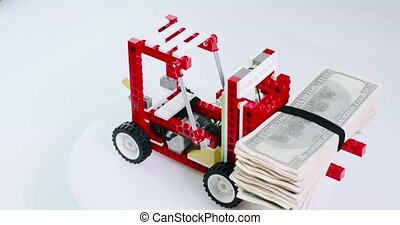child constructor forklift keeps a pile of money and turns.