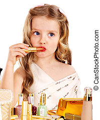 Child cosmetics. Little girl with lipstick.