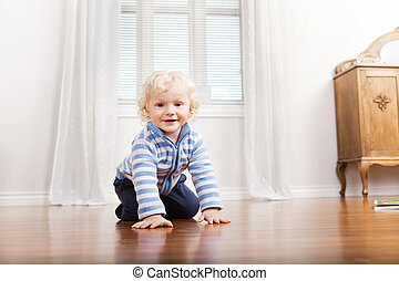 Child Crawling on Floor - Portrait of happy cute child...