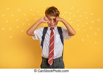 Child cries because does not want to go to school. Yellow ...