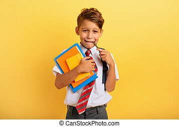 Child cries because he has a lot of school homework. ...
