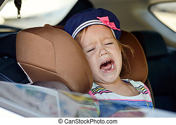 child crying in car - toddler girl crying in car