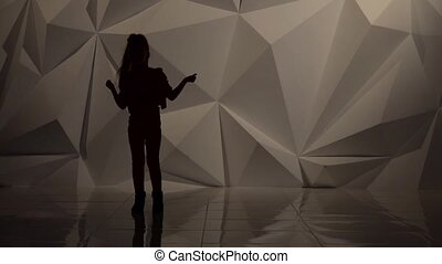Child dances hip hop . Silhouette. Slow motion. Geometrical abstract background