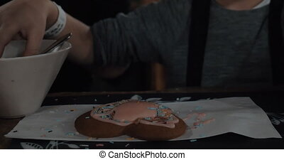 Child decorating cookie with sugar sprinkles - Boy learning...