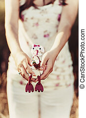 Child delivery by a white stork. Pregnant woman holding toy
