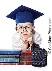 child development - Cute little boy in white shirt, a big...
