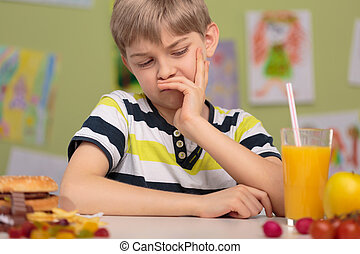 Child dislike healthy lunch - Image of child with grimace...