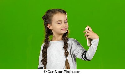 Child does selfie. Green screen - Child makes a selfie...
