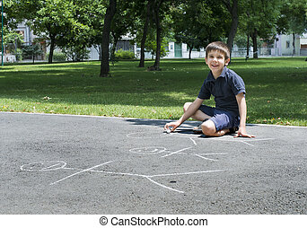Child drawing family on asphalt