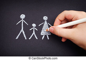 Child drawing family on black paper