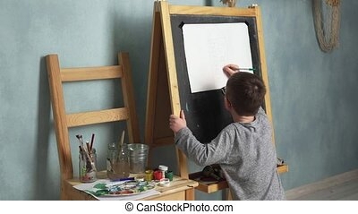 Child drawing house - Little boy draws house