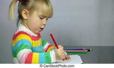Child drawing - Cute three year old girl blond hair sitting...