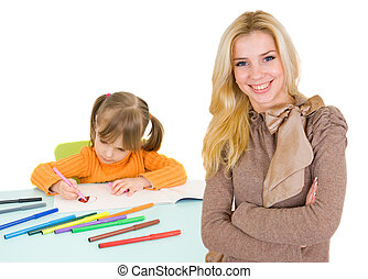 child draws and teacher