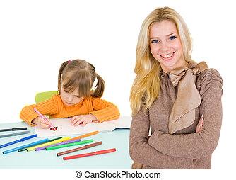 child draws and teacher